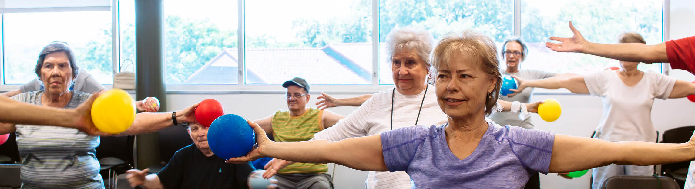 Active Older Adults working out in a group exercise class