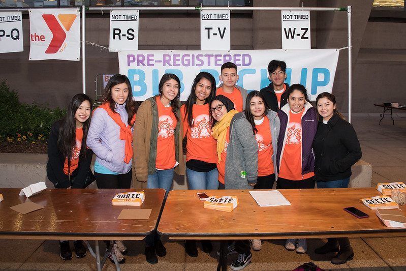A group of smiling volunteers at the pickup booth