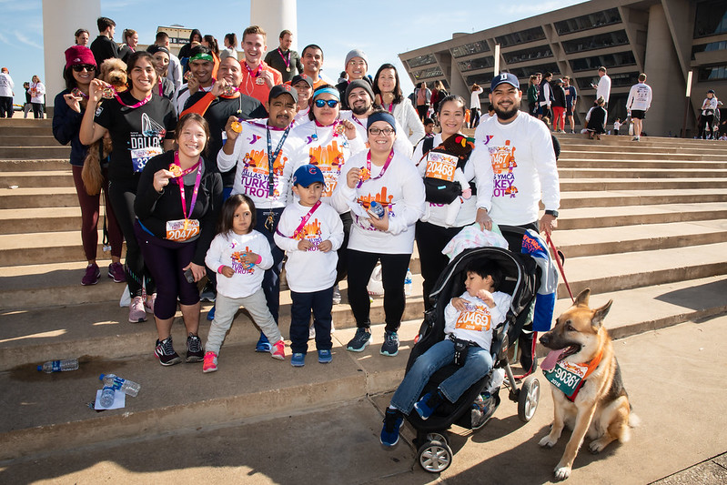 A large family standing on steps wearing turkey trot shirts