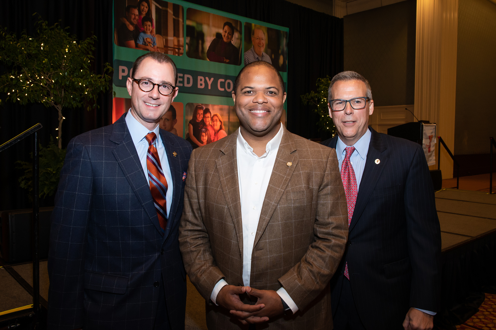 Creighton Webb, Mayor Eric Johnson, and YMCA Ceo Curt Hazelbaker smiling