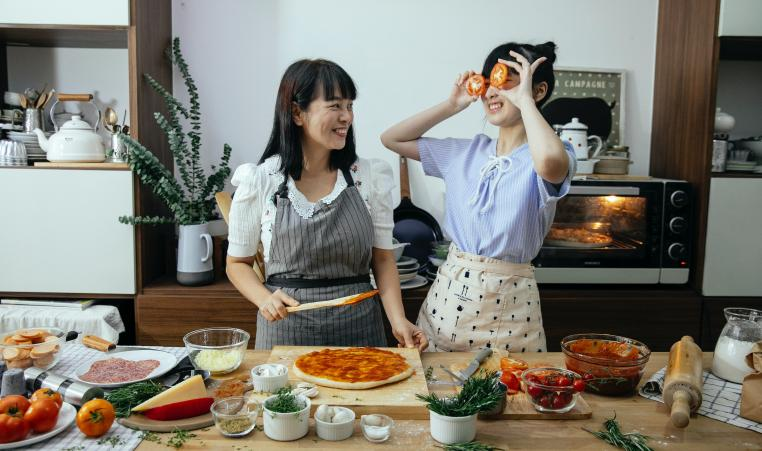 Asian Mom and Girl Cooking