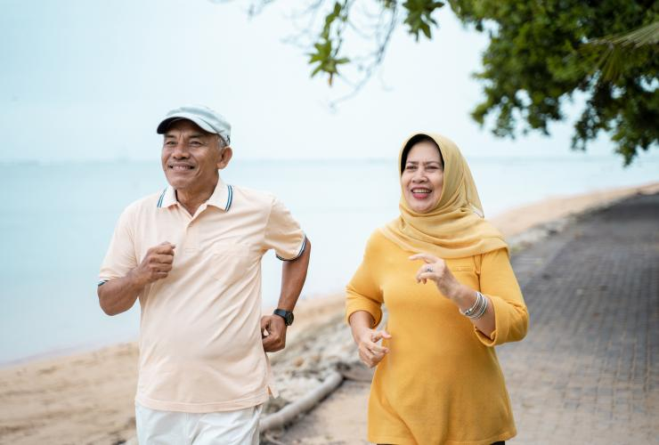 Muslim mature couple doing jogging together stock photo